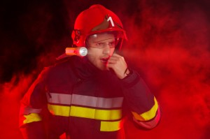 Firefighter in action using a walkie-talkie